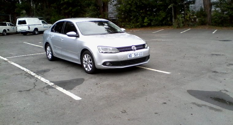 """2012 Volkswagen Jetta 1.4tsi Comfortline – Silver in colour – 107000kms with fsh, just been serviced, next service in 15000kms – 6 speed manual transmission – Aircon – Electric windows and mirrors – Power steering – Alarm and central locking – Radio and CD/MP3 player .auto lights coming home and going feature. .auto wipers. – Multi function steering wheel – factory fitted blue-tooth cell phone kit. – 16"""" Alloy wheels – Fog lamps .valid cor – Well maintained vehicle, drives well, and a good value for money family sedan A bargain at R129.500 neg. call 0842926659"""